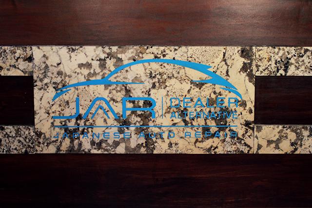 Japanese Auto Repair Logo on Granite