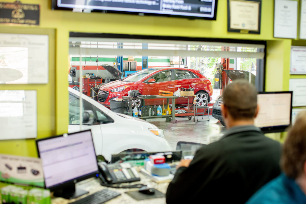 View of car shop inside the office