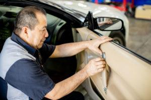 Technician fixing auto door